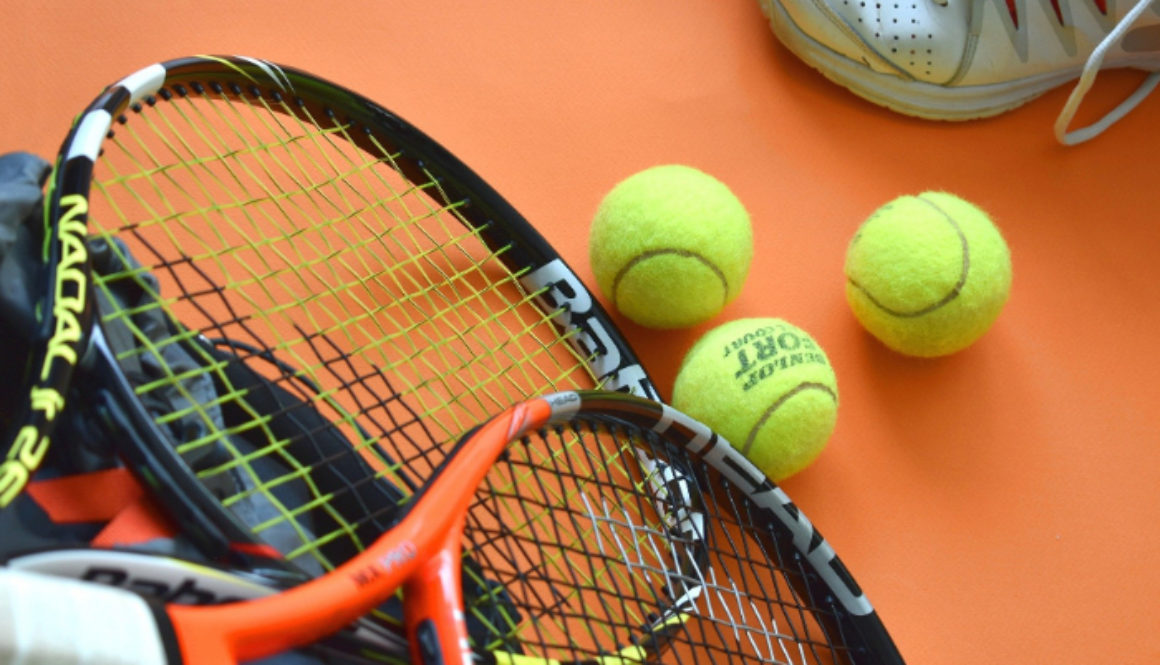 Sports Equipment with tennis racket and balls